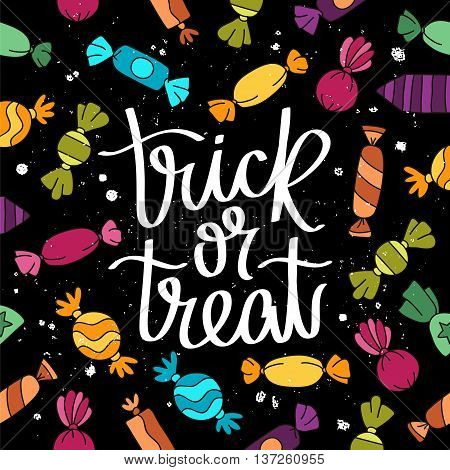 Trick or treat. The trend calligraphy. Vector illustration on a black background with different sweet candy. Excellent holiday card.