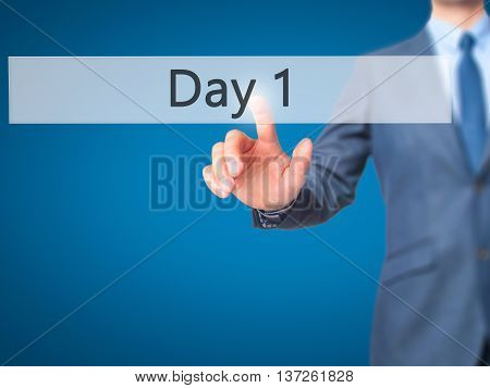 Day 1 - Businessman Hand Pushing Button On Touch Screen