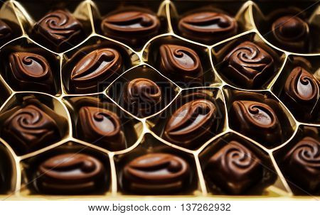 Chocolates in the box. Set of chocolate candies. Group of delicious chocolate pralines top view