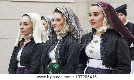 CAGLIARI, ITALY - May 1, 2013: 357 ^ Religious Procession of Sant'Efisio - Sardinia - portrait of beautiful girls in traditional Sardinian costume