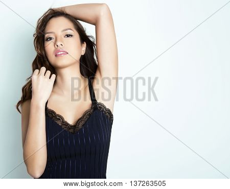 beautiful young asian woman with long hair, flawless skin and perfect make-up