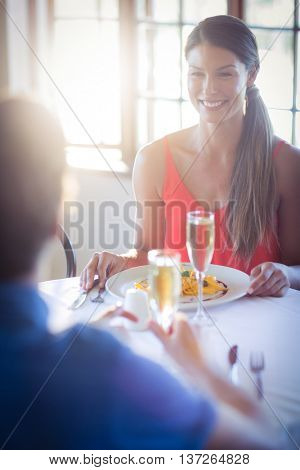 Young couple having lunch together in a restaurant