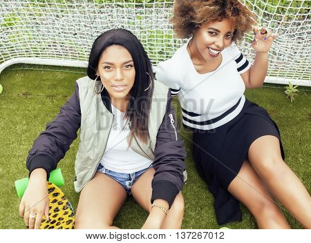 young pretty multi ethnicity afro-american girls having fun on foothball field, fan club of swag teenagers, best friends