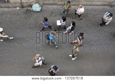 ROME ITALY - JUNE 17 2016: People passing by Lungaretta street in Trastevere pedestrian area
