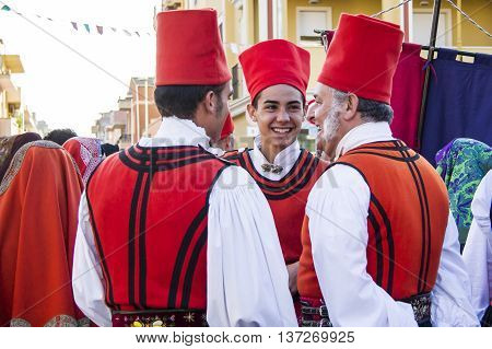 QUARTU S.It is,. ITALY - September 15, 2012: Parade of the Wine Festival 2012 - Sardinia - group of young people in traditional Sardinian costume folk group of Cagliari - Villanova.