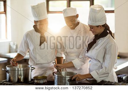 Head chef working together with her colleague in a commercial kitchen