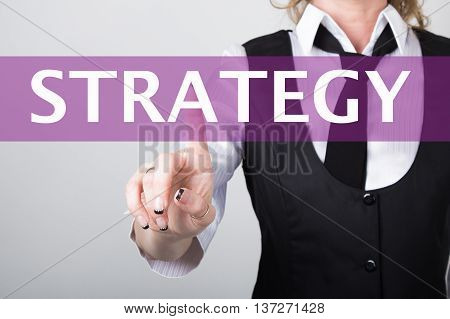 strategy written in search bar on virtual screen. technology, internet and networking concept. Internet technologies in business and home. woman in business suit and tie, presses a finger on a virtual screen.