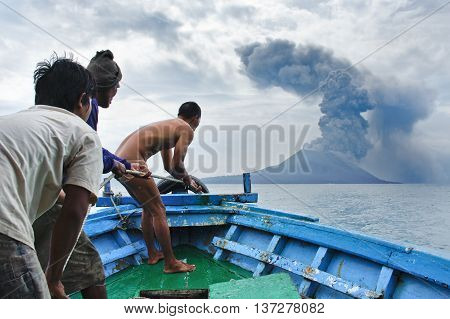 INDONESIA - JANUARY 20: Boat near volcano Anak Krakatau during eruption on January 20 2011.