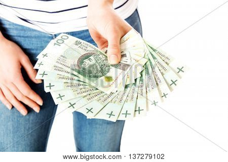 Girl's hand holds a fan of money on white background.