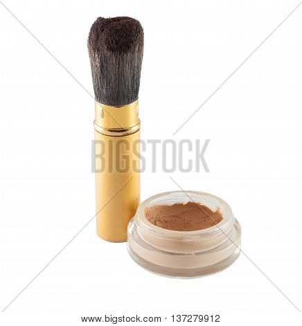 Brush with powder, tonal foundation on white background.