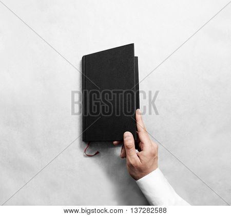 Hand open blank black book cover mock up template. Clear booklet surface design mockup. Arm holding opened textbook diary. Reading grey notebook copy. Closed catalog presentation display.