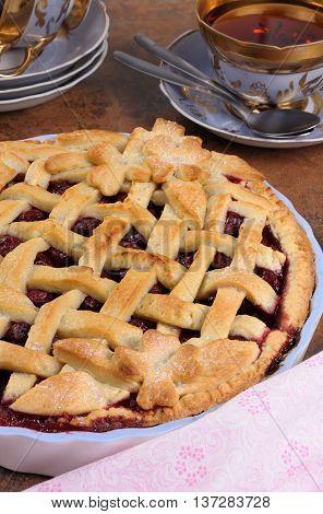 a cherry pie dough with decorative ornaments