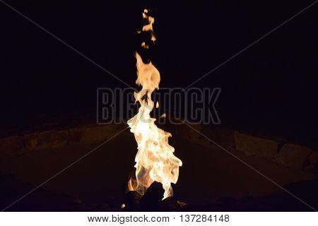 Lit fire in a fire pit taken in a residential yard