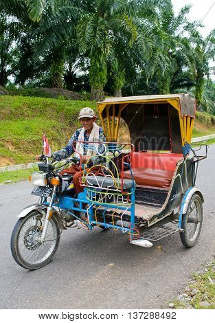 MEDAN INDONESIA - AUG 12: Auto rickshaw taxi on on Aug 12 2011 in Medan Indonesia. These taxis are popular type of transport among locals and tourists.