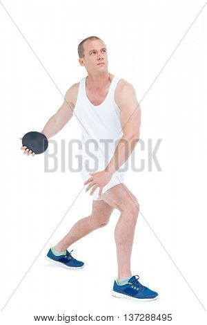 Athlete discus throwing on white background