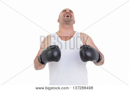 Boxer in boxing gloves laughing on white background
