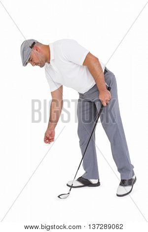 Golf player picking up golf ball on white background