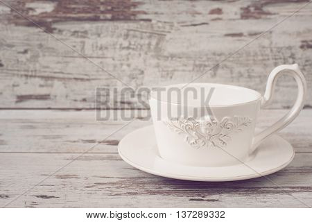 Simple Rustic White Crockery, Empty Dishes. A Large Cup Of Coffee In Front Angel. Wooden Background,