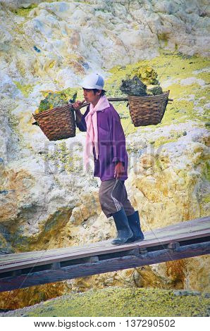 Worker Carries Sulfur Inside Crater Ijen Volcano, Indonesia