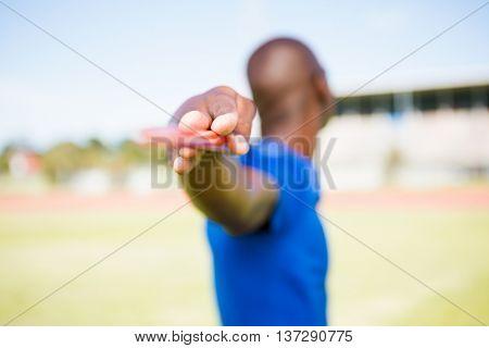 Athlete standing with javelin in stadium