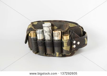 composition with a camouflage belt bullets and banknotes.