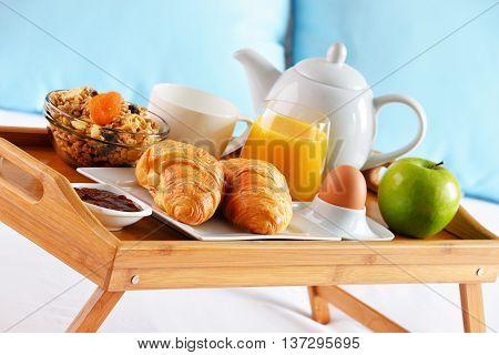 Breakfast On Tray In Bed In Hotel Room