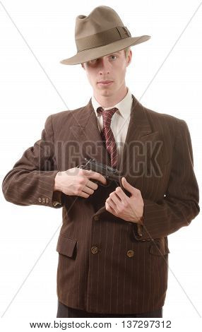 a gangster in a suit vintage with handgun on white background