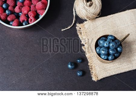 Fresh Raspberries And Blueberries Dark Picture With Copy Space On Left. Fresh Fruits, Berries In An