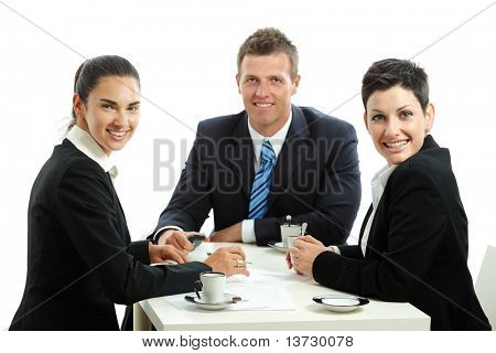 Young businesspeople having a coffee break, sitting at table. Isolated on white background.?