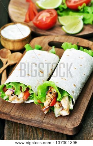 The Tortilla wrap on wooden cutting board