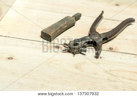 Cobblers shoemakers' tools on Wooden Worktop Bench