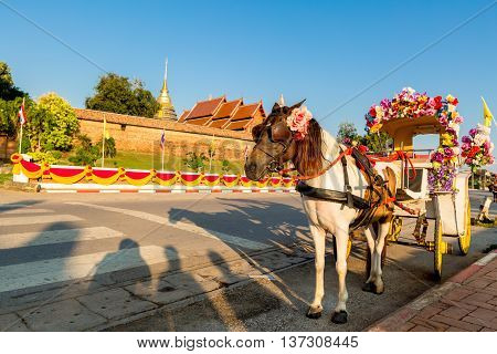 Traditional Horse Carriage at Wat Phra That Lampang Luang is a Lanna-style Buddhist temple in Lampang in Lampang Province Thailand.