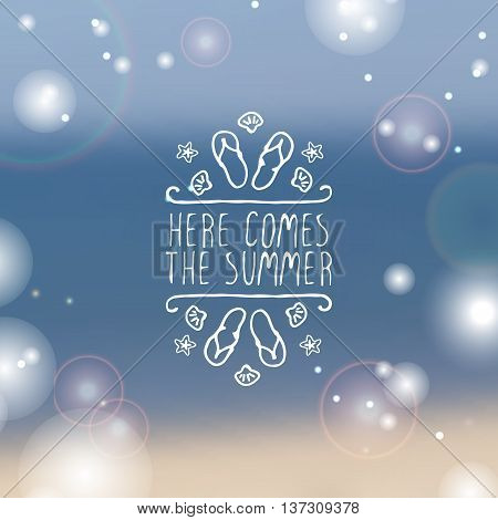 Hand-sketched summer element with flip flops and starfish on blurred background. Text - Here comes the summer