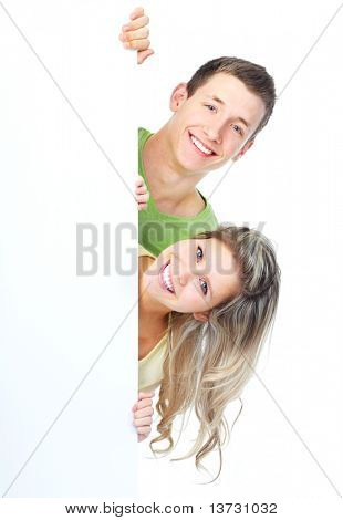 Young happy couple holding a white plackard
