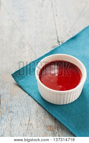 Red Sauce In White On A Blue Background