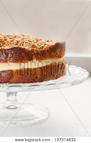 Cake With Cream Sprinkled Nuts And Honey