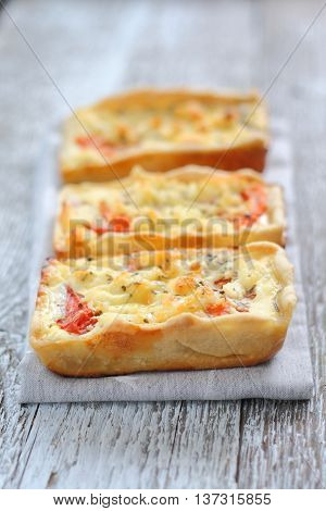 Mini pie with chicken and a tomato