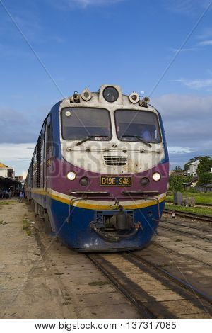 Hue, Vietnam - Jun 18, 2016: Close up of a train catching passenger in Hue Railway Station in the central Vietnam. The train is slow and noisy but very interesting for foreign travelers.