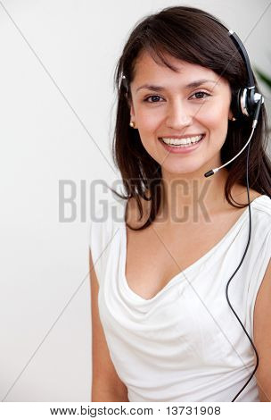 Female customer support operator with headset smiling