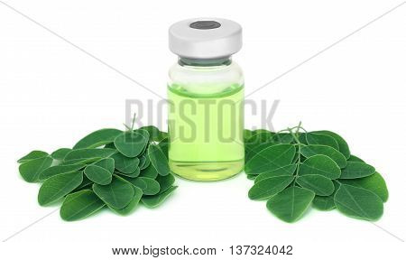 Moringa leaves with medicine in vial over white background