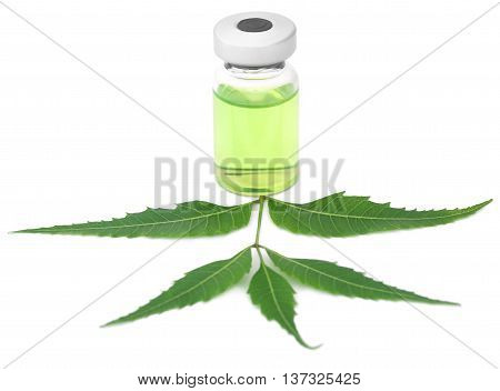 Medicinal neem leaves with a vial over white background