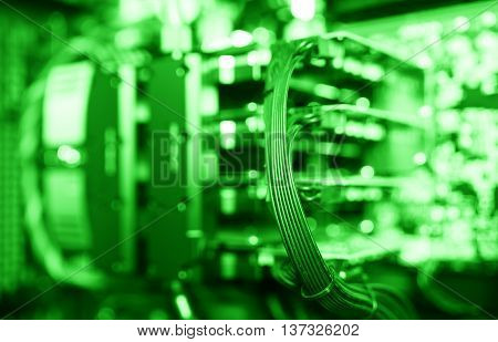 Horizontal green gpu quad sli video card bokeh background
