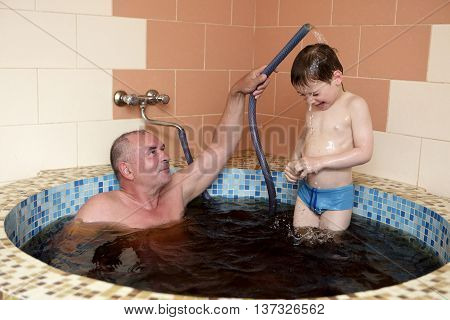 Grandfaher With Grandson In Jacuzzi