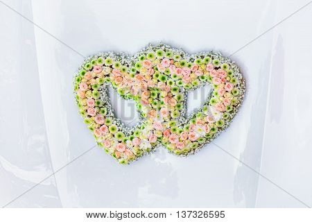 Wedding Bouquet in the Shape of a Hearts on the Car Bonnet