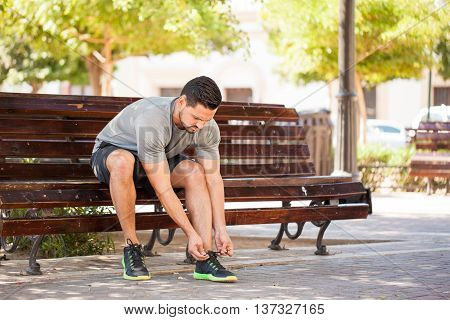 Man Tying His Shoes Before Going For A Run