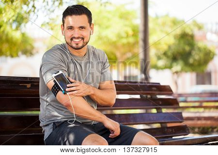 Hispanic Man Working Out With Music