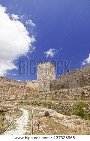 View of Lombardy Castle: footpath in Saint Nicholas courtyard and Torre Pisana (Pisana tower). Enna, Sicily