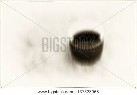 Horizontal vivid sepia coffee cup blur abstraction with dust particles background