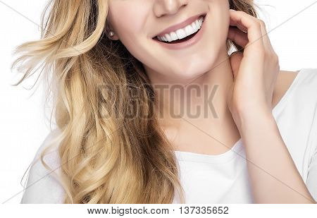 Part of face. Beautiful young blond smiling woman with clean face.