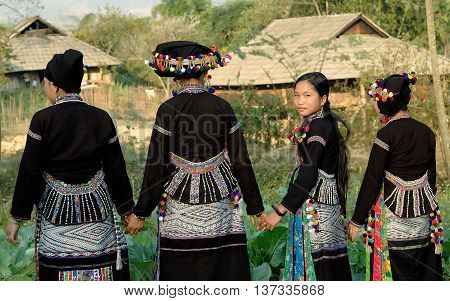 LAI CHAU, VIETNAM, February 14, 2016 the group of women, ethnic Hmong, highland Lai Chau, Vietnam, wearing traditional dress, walking in spring